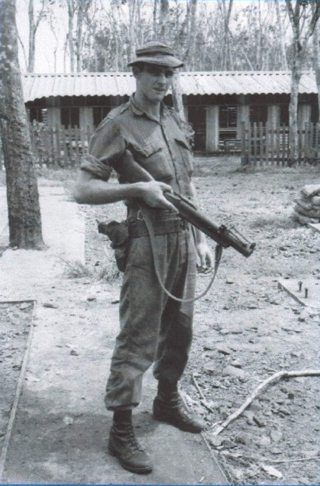7-Dog-handler 'Slim' Symington with an M79.