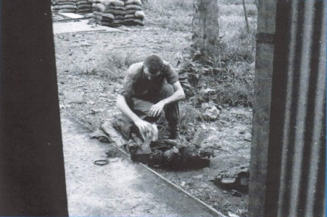 7-'Jock' McDonald checking his kit.